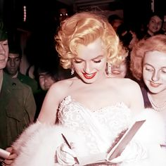 """Marilyn signing autograph's for fans at the premiere for """"How To Marry A Millionaire"""",  1953"""