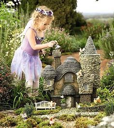 cutest Fairy house every....with an adorable little caretaker :) This is just like mine....