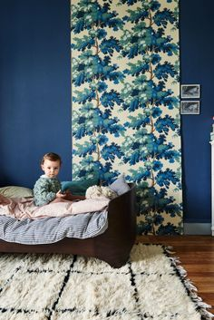 A strip of blue leaves and a geometric rug, quite lovely. #estella #kids #decor