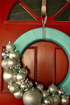 clare, I was thinking, we can buy a light-wt wreath, wrapped it with our theme colored ribbon tape, and dangle our photos in the middle. We should try to make one!