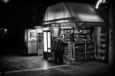 I found this meeting interesting, because the lady that was purchasing something, was talking to the kiosk manager in rather suspicious tones. Also, I found the lighting very interesting in this scene. Kiosk, Late Nights, Greece, Black And White, Black White, Blanco Y Negro, Grease, Black N White