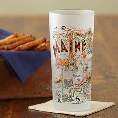 Maine Map Drinking Glass - This tall, well designed, frosted drinking glass will show your affection for our favorite New England State. This original design celebrates the State of Maine from Kennebunkport to Moosehead Lake to Portland and all the good places in between. Caricatured map design is created by two California designers. We feature the states in which Stonewall Kitchen Company Stores are located.
