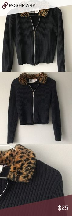 VINTAGE Ribbed Cheetah Fur Long Sleeve Crop Top This vintage zip up top is perfect for staying warm while remaining stylish! It's such a unique top and is great condition! Lined with faux cheetah fur around the neck adding an awesome touch! Pair with high waisted black jeans or a black skirt for a certified posh fashionista look ! Size Small   VINTAGE Ribbed Cheetah Fur Long Sleeve Crop Top Vintage Tops