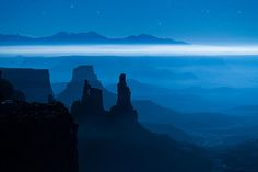 """""""Blue Moon Mesa"""" the """"Washer Women"""" under moonlight in Canyonlands National Park. This image was on display in the Utah Museam of Natural History as part of their Wilderness 50 exhibit."""