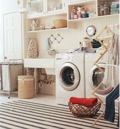 laundry room with charm and plenty of storage spots. photo: John Gruen