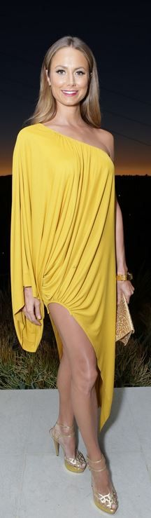 Who made Stacy Keibler's yellow one shoulder gown, gold sandals, and gold jewelry that she wore in Beverly Hills on August 22, 2013?