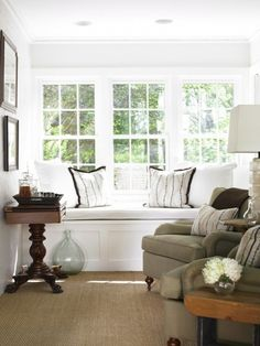 Suzie: Courtney Giles Interiors - Beautiful sunroom with built-in window seat, white & black ...