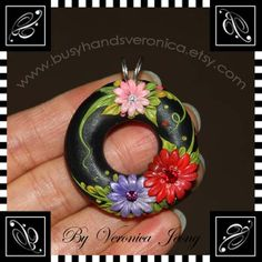 I embroidered flowers with bits of polymer clay on brass filigree adjustable ring.  Just like tiny stitching on cloth. See you at Etsy :)