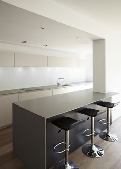 The kitchen perfectly complements the contemporary extension and the clients' lifestyle.