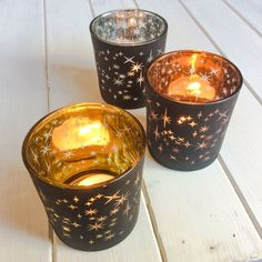 Gold Stars Votive - Large Cosy down with these gorgeous flickering star votives The clear star shapes in the coating of the glass cast beautiful flickering star patterns around the room once the candle is lit.  Why we love this product:      Casts a dazzling stellar display once lit     They look amazing on their own of as part of a group     Complete with tea-light candle to enjoy straight away!   #candles #glass #votives #stars #rustic #home #interiors #decor #sparkling