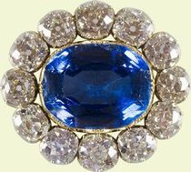 Queen Victoria's Wedding Brooch. The day before her wedding, Queen Victoria wrote of gift from 'dearest Albert' of 'a splendid brooch, a large sapphire set round with diamonds, which is really quite beautiful'. She wore the brooch on her wedding day and on many subsequent occasions. The brooch was probably supplied by a leading London jeweller such as Kitching & Abud or Mortimer & Hunt, both of whom Prince Albert patronised significantly in the early years of his marriage.