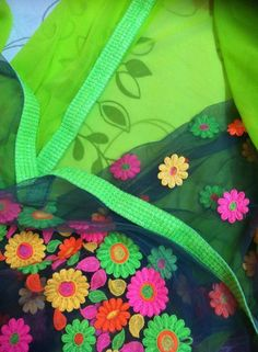 half n half Neon green Georgette saree with sequence border and grey net aanchal. Beautiful neon flowers on the pallu makes it even more attractive.