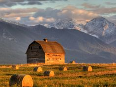 Old Barn Framed By Hay Bales, Mission Mountain Range, Montana Country Barns, Old Barns, Country Life, Country Living, Old Bridges, Scenic Photography, Photography Tips, Hay Bales, Farm Barn