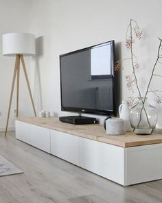 Scandinavian low TV bench using IKEA BESTA cabinets and long piece of wood on top