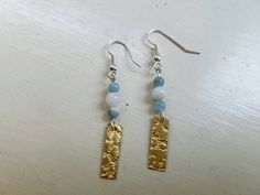 Check out this item in my Etsy shop https://www.etsy.com/listing/456293292/textured-brass-earrings-aquamarine-and