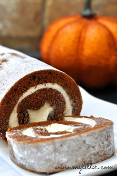 AMAZING Easy Pumpkin Roll Recipe that your friends and family will love! Treat them to a fall favorite using canned pumpkin and cream cheese frosting.