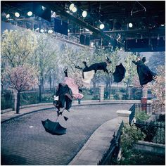 """""""Nannies"""" (actually well-costumed stuntmen) are blown away by special effects """"wind"""" on the Cherry Tree Lane set built in the Disney Studio's Stage 4 during the production of Mary Poppins, 1964 Walt Disney, Disney Love, Disney Magic, Disney Art, Disney Pixar, Disney Films, Disney Characters, Mary Poppins 1964, Musicals"""