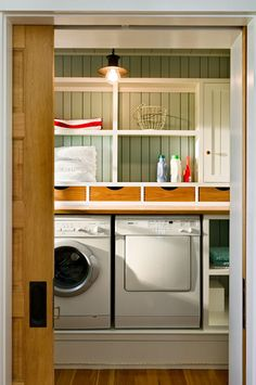 Out of sight, out of mind! Great hidden storage for your laundry room. Storage Solutions We Love at Design Connection, Inc. | Kansas City Interior Design http://designconnectioninc.com/blog/ #LaundryRoom #InteriorDesignInspiration #StorageSolutions