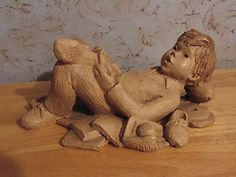 Lee Bortin Sculpture:  Boy Reading A Book, Relaxing, Surrounded by His Toys
