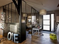 industrial room soparators; great idea for a home office // via art et decoration