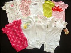Beautiful Carters bodysuits! Nine of them, great condition, some New and Like New!