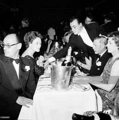 Duke Edward and Duchess (Wallis Simpson) of Windsor december 10, 1959 at Lido, Paris. The duchess is wearing a diamonds necklace by Cartier (-1937) and a Tiger bracelet by Cartier (-1956).