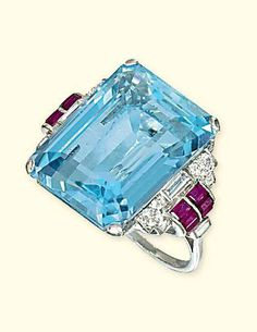AN ART DECO AQUAMARINE, DIAMOND AND RUBY RING, BY BOUCHERON  The rectangular-shaped aquamarine to the geometric shoulders mounted with circular and baguette-cut diamonds to the calibré-cut ruby accents Signed Boucheron
