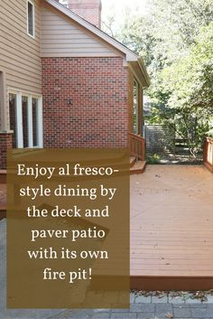Make a sanctuary out on the custom deck of this Naperville home for sale that's surrounded by a serene wooded area.