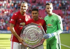 United's two goalscorers Ibrahimovic and Lingard pose for a photo with goalkeeper De Gea o...