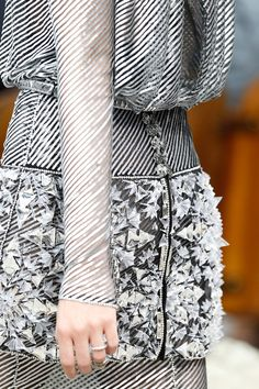 Silver bias stripes and dimensional geometric embellishment; structured fashion; closeup couture; fashion details // Chanel
