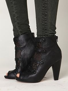 Love these peekaboo boots. Do not like the skinny jeans...would prefer wide leg slacks.