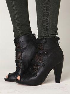 Love these peekaboo boots. Do not like the skinny jeans...would prefer wide leg slacks.