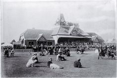 Balloon ascent, Lancaster Park (NOT LORRAINE) [between Dec. 1910 and Jan. 1911] The Beebe Balloon Company, formed by an American, put on several ballooning exhibitions at Lancaster Park in front of large crowds. Pictured is the pavilion and grandstand (later the no. 1 stand), built in 1880 at a cost of £1,530, and demolished in 1958
