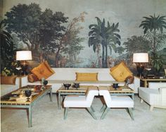 Love layout of sofas joined together at corner with tables and lamsp and palms in backgrouns