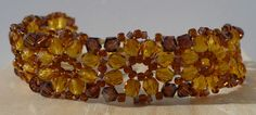 Swarovski Topaz Crystal and Honey Fire Polish Bead Bracelet - 7 Inches. $37.00, via Etsy trinkets by Thandeka