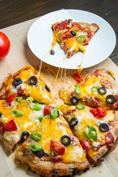 Taco Quesadilla Pizzas Recipe : Taco meat and cheese stuffed quesadillas made pizza style topped with salsa and even more melted cheese! Carnitas, Barbacoa, Tostadas, Tacos, Mexican Dishes, Mexican Food Recipes, Dinner Recipes, Mexican Pizza, Mexican Cooking