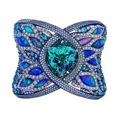 This spectacular fine jewellery Arunashi cuff set in blue titanium and gold features a 23ct central Paraíba tourmaline, opals and diamonds.