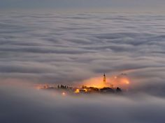 A town in Asiago, Italy, shrouded in fog. Taken from a mountaintop. So pretty.