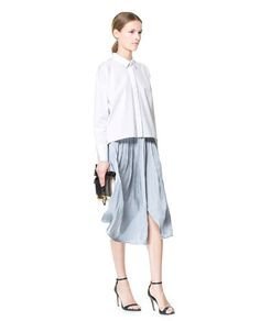 Image 1 of SKIRT WITH CONTRASTING BOX PLEATS from Zara