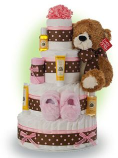 "This beautiful pink contemporary design is loaded with the finest ingredients including A Gund™ brand Ultra Soft ""Fleming"" teddy bear and Burt's Bees specialty baby supplies. Only $96.00"