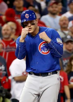 Anthony Rizzo #44 of the Chicago Cubs reacts on third base after a single hit by Ben Zobrist #18 (not pictured) during the first inning against the Cleveland Indians in Game Six of the 2016 World Series at Progressive Field on November 1, 2016 in Cleveland, Ohio.