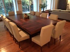 Large Dining Room Table Seats 12 With Decoration In Wood Floors Also The Design Of White Chairs And Plant