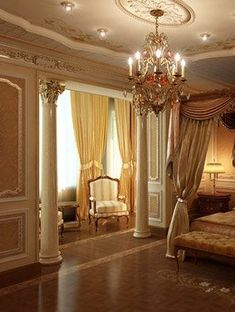 Luxury Bedroom. I like the columns and the separation of the sitting area.