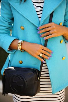 turquoise pea coat with black and white