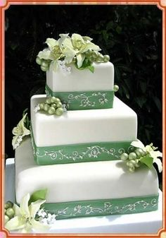 Floral Cake  A white wedding cake with green flowers. Maybe purple flowers instead of green