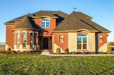 The Amelia II designed with an Old World elevation style . Built in Americana Estates. Old World Style, Amelia, Luxury Homes, Golf Courses, Community, Mansions, House Styles, Building, Pictures