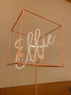 Copper leaf structure with suspended acrylic and vinyl name for sweet Ellie!