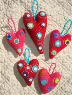 felted and embroidered sweater hearts