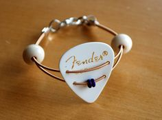 Items similar to Guitar Pick and Guitar String Bracelet - Dual Strings - Taylor on Etsy Guitar Pick Jewelry, Music Jewelry, Wire Jewelry, Jewelry Crafts, Handmade Jewelry, Jewlery, Bead Jewellery, Handmade Crafts, Guitar String Bracelet