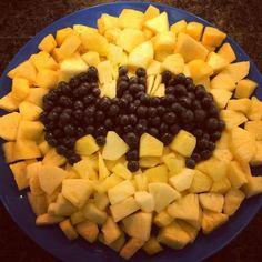 Pineapple, mango and blueberries for the Bat-signal fruit platter. Batman and Villains superhero themed birthday party.